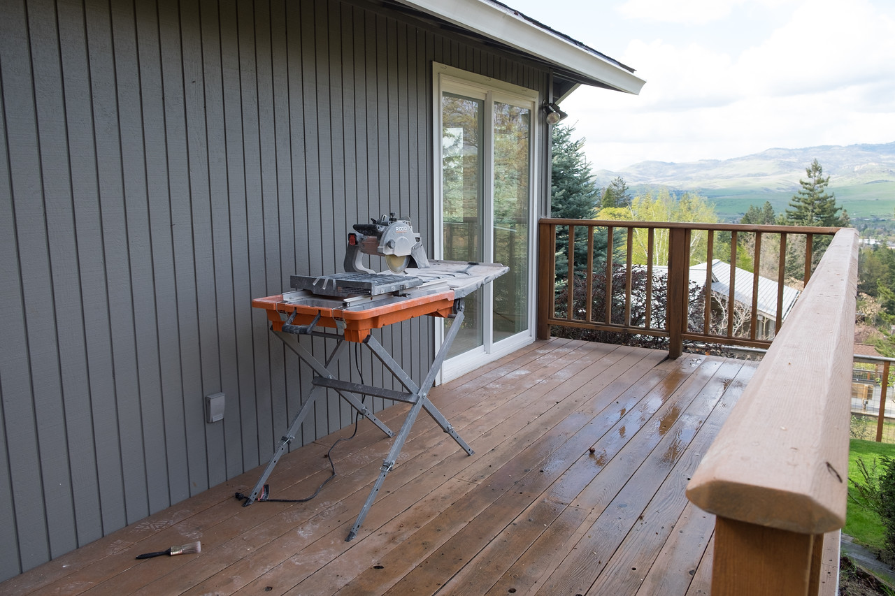 The tile saw sits waiting on the back deck.