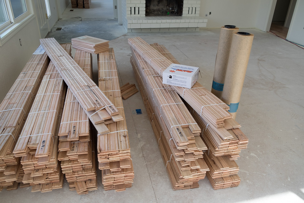 """Part of the wood flooring """"conditioning"""" in the living room."""