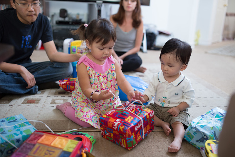 Remy helps Noah open his presents.