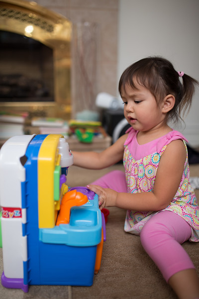 Remy plays with the little kitchen