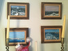 4 small paintings in dining room