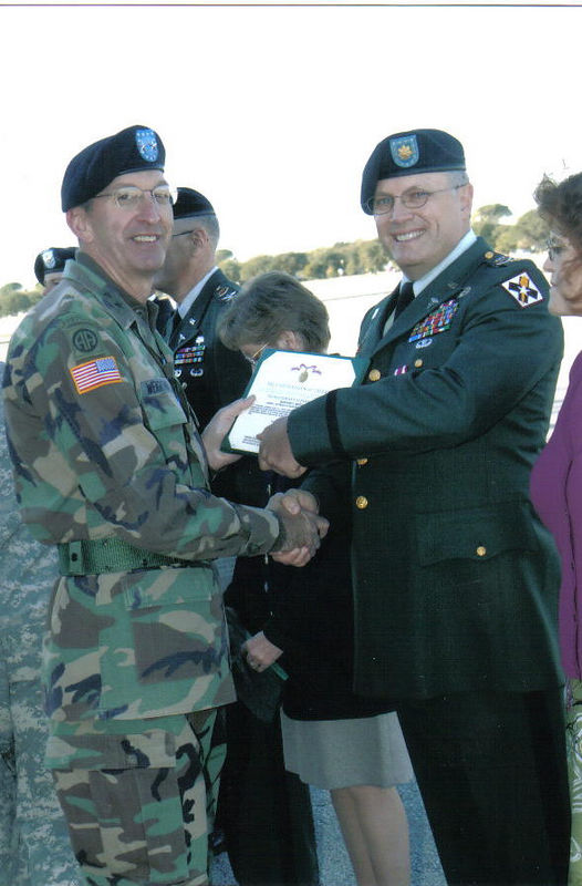 Presentation of retirement award (Meritorious Service Medal) to Harry by MG Weightman