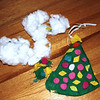 What makes a memory?  I began to ponder this question when I realized that Juno had disemboweled our oldest ornament, made by Lillian and me when she was 13 months old.  Of course I'll mend it.  But just looking at the object doesn't tell you how we made it.  I prepared a green tree and cut out felt shapes.  Lillian loved to paste things, with some help with paste applications.  Collage was one of our favorite activities!