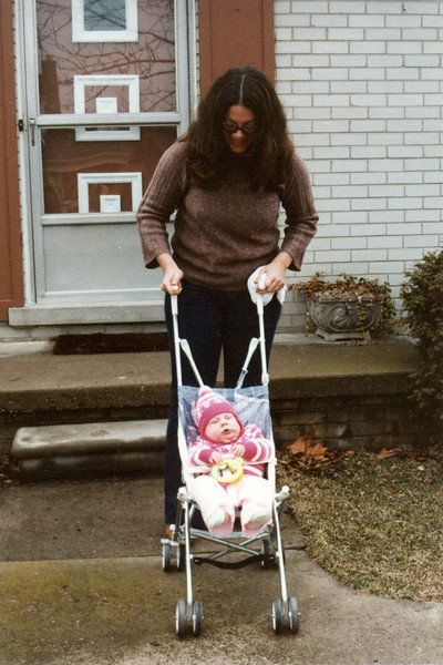 Here we are on a visit to Michigan.  Get a load of that crappy stroller!  But that's what they had then.   If they'd had them then, we'd have tried to get one of those fancy three-wheelers, shock absorbers and all.