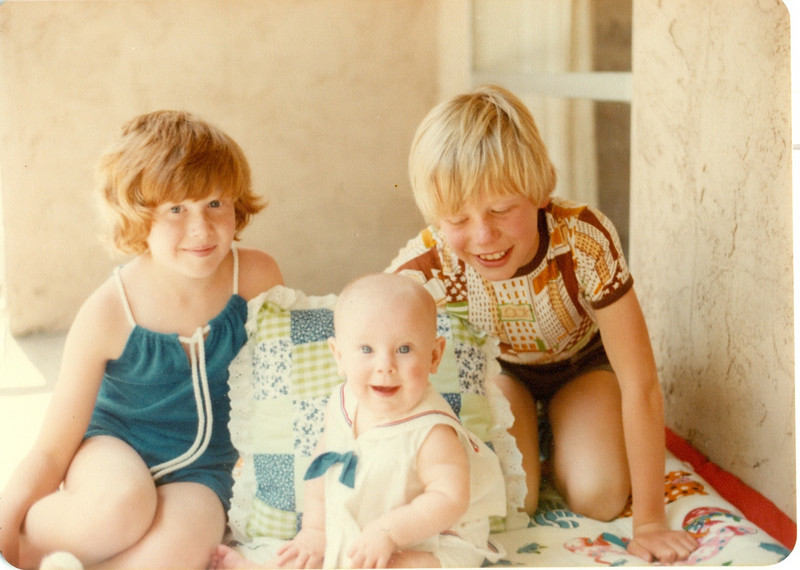 Here we are on the porch of our apartment in San Jose, with the little English children from next door.  Older children liked to play with you -- you were such a cheerful little gal.  Their mom was horrified that we liked to watch that lowbrow Benny Hill.