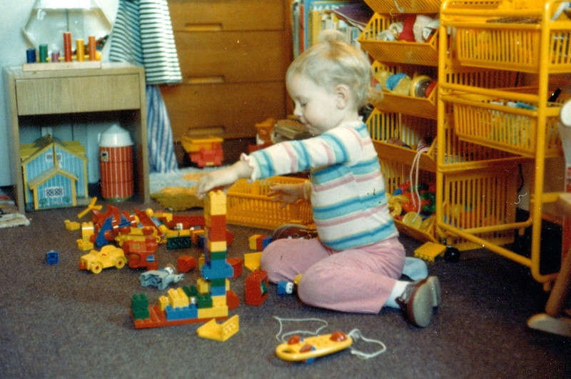 In your room at MIT, playing with your beloved Legos.  You were really absorbed by them, and they were a good toy for quite a few years.