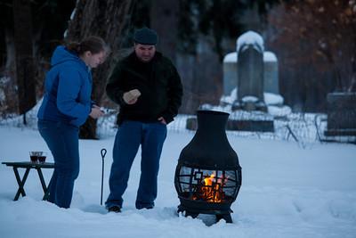 Jennifer and Jon start a fire in the back yard abutting the grave yard.