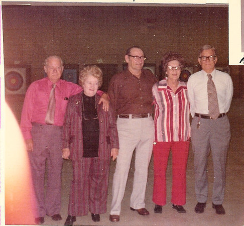 reunion73e569x527:  Family reunion in Phil's Archery shop in Austin.  <br /> Let t right, David West Amsler, Dana Hawkins Amsler, Leon Kurc, Lillian Kurc, Louis Philip Amsler (older brother to David West)