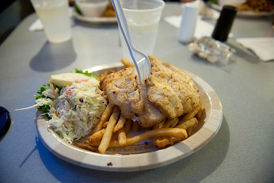 Looks like baked haddock with fries and slaw.