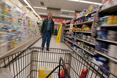Peter doesn't quite know what to do with me. Unfortunately, I didn't pay any attention to how the cart looked in these shots. It should be half-filled with grocery-store things, not these inexplicable black hoses. Actually, those are the handles of the little hand-carry shopping cart with rhubarb sticking out.