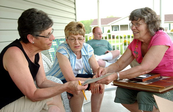 Juanita, Mary Lou & Mom (Kathy) looking at old photos and scrapbooks on Juanita & Dean's porch
