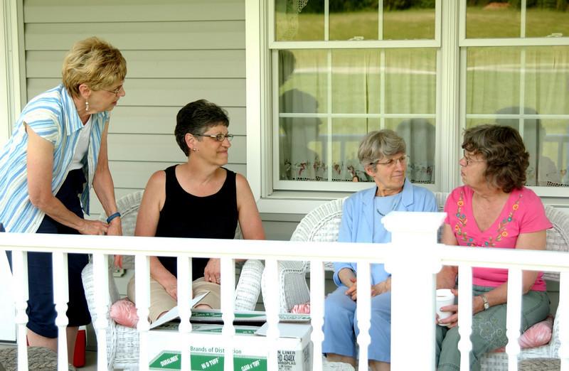 Sisters - Mary Lou, Juanita, Phyllis & Mom (Kathy) on Juanita's porch