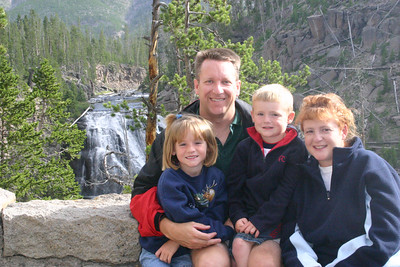 Pat, Kathy, Sydney and Christopher at Gibbon Falls in Yellowstone National Park.