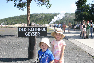 Christopher and Sydney after the eruption of Old Faithful Geyser in Yellowstone National Park.
