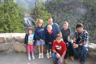 Family photo next to Gibbon Falls in Yellowstone National Park. From left: Rachel, Sydney, Christopher, Uncle Andrew, Chris, James (Chris' cousin) and Donald.