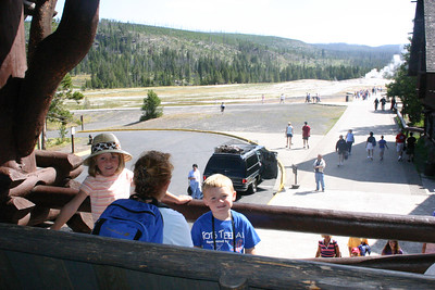 Kathy with Sydney and Christopher on the deck at Old Faithful Inn. Kathy said she could have spent all day out there.