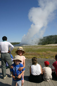 Christopher and Sydney in front of Old Faithful Geyser in Yellowstone National Park. Our timing was perfect as we didn't have to wait long to see it erupt.