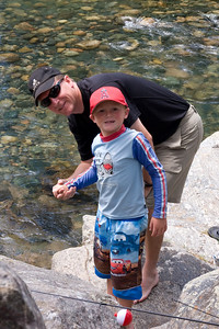 2007 Kane Family Reunion. We enjoyed an afternoon of wading and fishing in the Vallecito Creek near the Vallecito Campground at the end of CR-500, which is above Vallecito Reservoir. At close to 8,000-ft elevation, you could count on the water being cold and it dang sure was! We weren't sure if there were any fish in the creek as the campground host said they only pulled one a day out of the river near the campground. Supposedly the better fishing was upstream along the Vallecito Creek Trail in the Weminuche Wilderness, so Frank, Grady and Nathan took the four mile hike upstream and returned with three small trout (two for Nathan and one for Grady). Christopher skipped the hike and caught two small trout right at the campground. Apparently the bigger fish were only a few yards upstream as we saw another camper walk by with several large trout. Here's a good description of the creek: http://gorp.away.com/gorp/publishers/pruett/fis_soc2.htm. (Image taken with Canon EOS 20D at ISO 400, f11.0, 1/100 sec and 44mm)