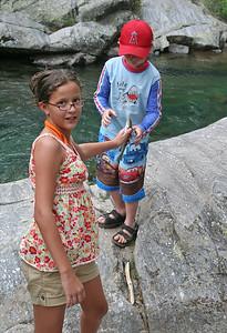 Katy Cano holding Chris Kane's fish at Vallecito Creek, Colorado 7/16/07