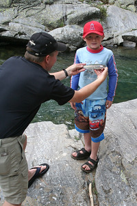 """Pat holding the """"big one"""" Chris caught at Vallecito Creek, Colorado 7/16/07"""