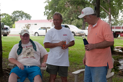 A closer look at some of the washer pitching losers - Michael and Russ Kane and Shorty Giacomazzi. 2010 Kane / Kennemer Family Reunion in Canton, Texas (Image taken by Patrick R. Kane on 21 Jul 2010 with Canon EOS 20D at ISO 100, f5.6, 1/125 sec and 48mm)