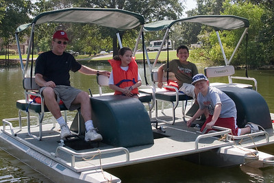 Pat, Sydney and Christopher Kane and Joey Cano getting ready to try out the paddle boats. 2010 Kane / Kennemer Family Reunion in Canton, Texas (Image taken by Patrick R. Kane on 21 Jul 2010 with Canon EOS 20D at ISO 100, f8.0, 1/200 sec and 28mm)