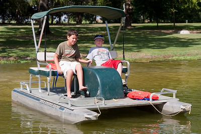 Joey Cano and Christopher Kane on paddle boat. 2010 Kane / Kennemer Family Reunion in Canton, Texas (Image taken by Patrick R. Kane on 21 Jul 2010 with Canon EOS 20D at ISO 100, f7.1, 1/250 sec and 53mm)