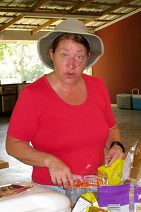 Kelley Kane latched onto Russ Kane's hat and kept it - may have put her name in it. She balked a little when Grady told her how much Russ paid for it... 2010 Kane / Kennemer Family Reunion in Canton, Texas (Image taken by Kathy L. Kane on 21 Jul 2010 with Canon PowerShot SD870 IS at ISO 0, f4.5, 1/60 sec and 10.8mm)