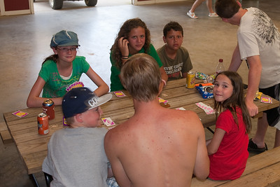 Grady Roth is teaching Sydney Kane, Katie Cano and Rachel Kane how to play Hand and Foot with Christopher Kane, Joey Cano and Willy Winborne looking on in the pavilion. 2010 Kane / Kennemer Family Reunion in Canton, Texas (Image taken by Patrick R. Kane on 21 Jul 2010 with Canon EOS 20D at ISO 100, f4.0, 1/60 sec and 28mm)
