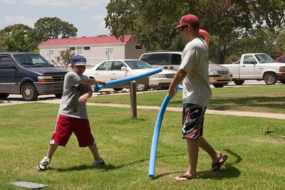 Christopher Kane and Ryan Roth heading to the swimming pool - oops, looks like they decided to have a little battle. 2010 Kane / Kennemer Family Reunion in Canton, Texas (Image taken by Patrick R. Kane on 21 Jul 2010 with Canon EOS 20D at ISO 100, f9.0, 1/250 sec and 44mm)