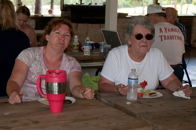 Tracy and Mary Clare Kane having a bite to eat in the pavilion. 2010 Kane / Kennemer Family Reunion in Canton, Texas (Image taken by Patrick R. Kane on 21 Jul 2010 with Canon EOS 20D at ISO 100, f4.0, 1/60 sec and 44mm)