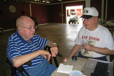 Bill and Grady Kane sitting in the pavilion. 2010 Kane / Kennemer Family Reunion in Canton, Texas (Image taken by Kathy L. Kane on 21 Jul 2010 with Canon PowerShot SD870 IS at ISO 0, f2.8, 1/60 sec and 4.6mm)