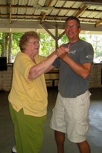 Frank Cano dancing with Myra Kane in the pavilion. 2010 Kane / Kennemer Family Reunion in Canton, Texas (Image taken by Kathy L. Kane on 21 Jul 2010 with Canon PowerShot SD870 IS at ISO 0, f2.8, 1/60 sec and 4.6mm)