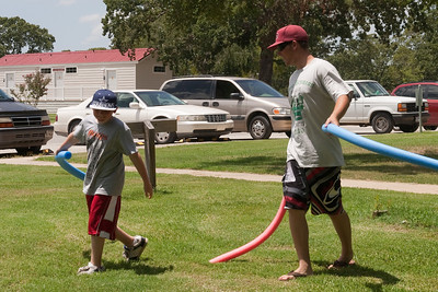 Christopher Kane and Ryan Roth dueling with pool noodles. 2010 Kane / Kennemer Family Reunion in Canton, Texas (Image taken by Patrick R. Kane on 21 Jul 2010 with Canon EOS 20D at ISO 100, f9.0, 1/250 sec and 44mm)