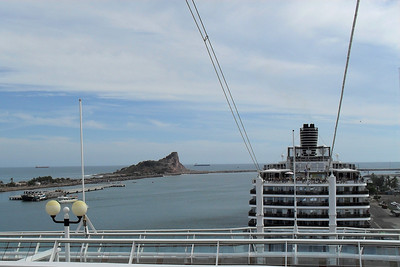 Mexican Riveria Cruise – Norwegian Star on Norwegian Cruise Lines Day 4 – Tue, 3/23 – Mazatlan, Mexico Entertainment – Team Rootberry View of the Holland America ship from our top deck.