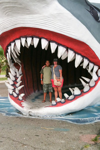 Benny and Cindy standing in the mouth of a giant shark at Destination Beach & Surf, Port Aransas, Texas. 2012 Kane / Kennemer Family Reunion in Rockport, Texas  (Image taken by Cindy on 11 Jul 2012 with iPhone 4 at ISO 80, f2.8, 1/120 sec and 3.9mm)