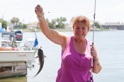 """Kathy became a fishing monster after she caught this fish. She didn't want to stop fishing, and she even bought a """"Fishing for Dummies"""" book when she returned home to Virginia. 2012 Kane / Kennemer Family Reunion in Rockport, Texas (Image taken by Patrick R. Kane on 14 Jul 2012 with Canon EOS 5D at ISO 200, f5.6, 1/250 sec and 70mm)"""