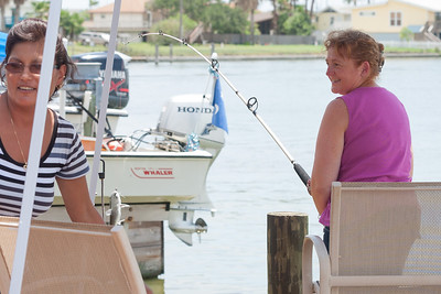 """Kathy became a fishing monster after she began reeling in her catch. She didn't want to stop fishing, and she even bought a """"Fishing for Dummies"""" book when she returned home to Virginia. 2012 Kane / Kennemer Family Reunion in Rockport, Texas (Image taken by Patrick R. Kane on 14 Jul 2012 with Canon EOS 5D at ISO 200, f5.6, 1/250 sec and 70mm)"""