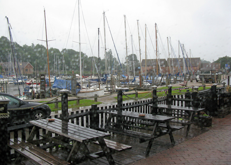 A view of Eling Quay through the rain spattered window of the pub.