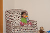 "Reya in her ""milk"" chair"