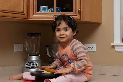 Ria enjoys making Roti. For a 2-yr old, she does pretty well!