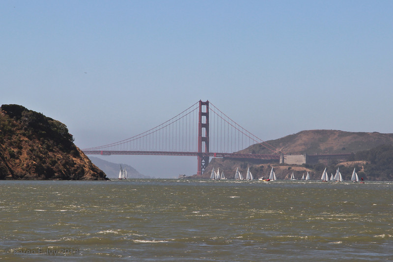 The Golden Gate Bridge, with sailboats