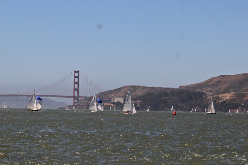 Racing boats against the Golden Gate Bridge