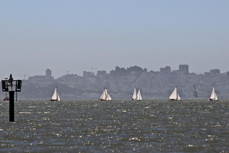 Sailboats against the city skyline