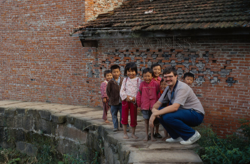 Rob with a bunch of kids who were running after him and giggling - in fields behind SWPI.