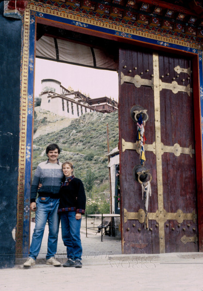 Us (Rob and Anna Lisa) at the Lhasa gate, with part of the Potala visible in the background