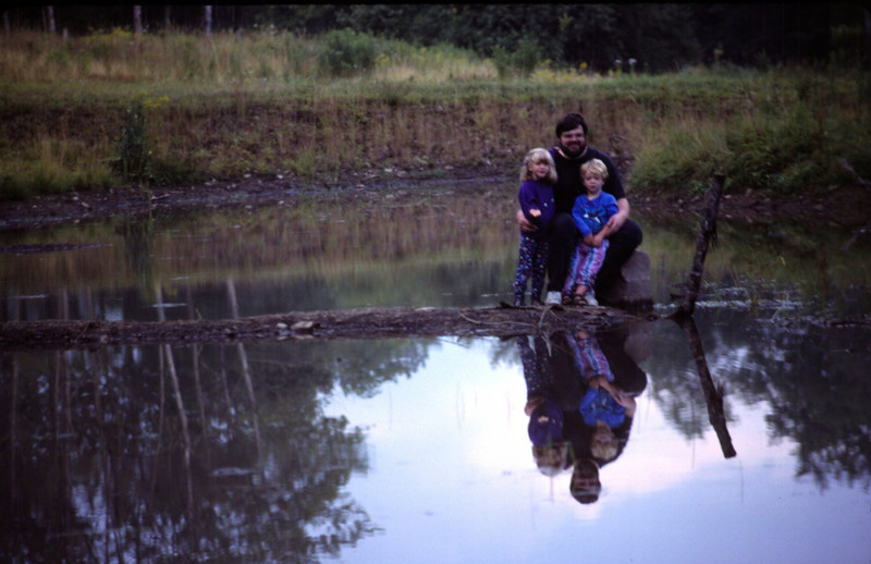 Rob with Lydia and Seth watching the beaver in pond at Moody Hollow