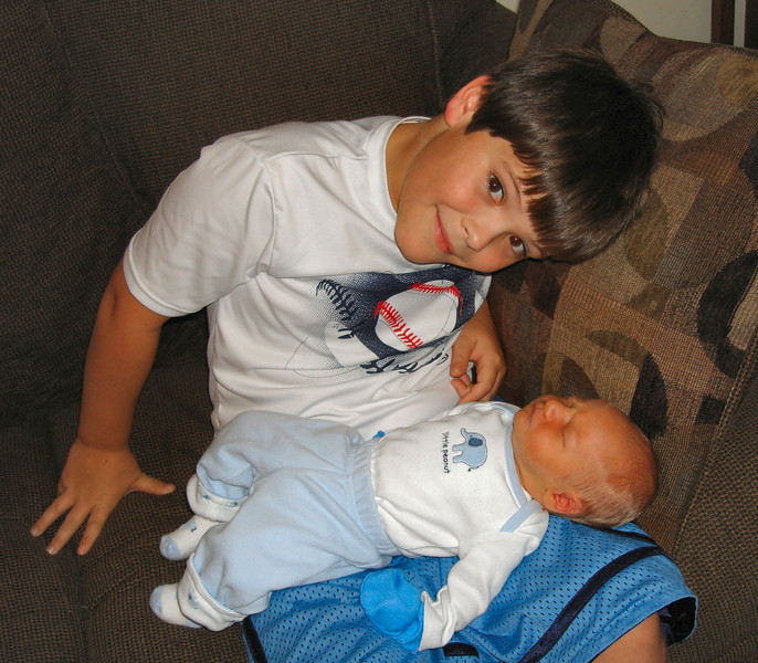 "2 days old....""My brother Noah's lap is just perfect to take a snooze"""