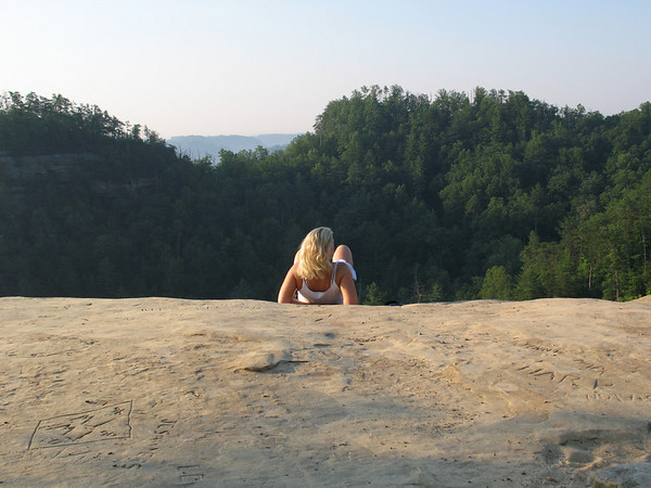 Dusti catching some morning sun on The Natural Bridge while at the Red River Gorge KY