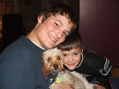 "Aj and Noah with Penny's old dog ""pork-chop"""